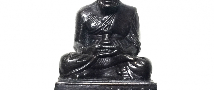 Loi Ongk Monk Statuette of Legendary Buddhist Saint Luang Phu Thuad containing a Lucky Metal Rian Coin Amulet